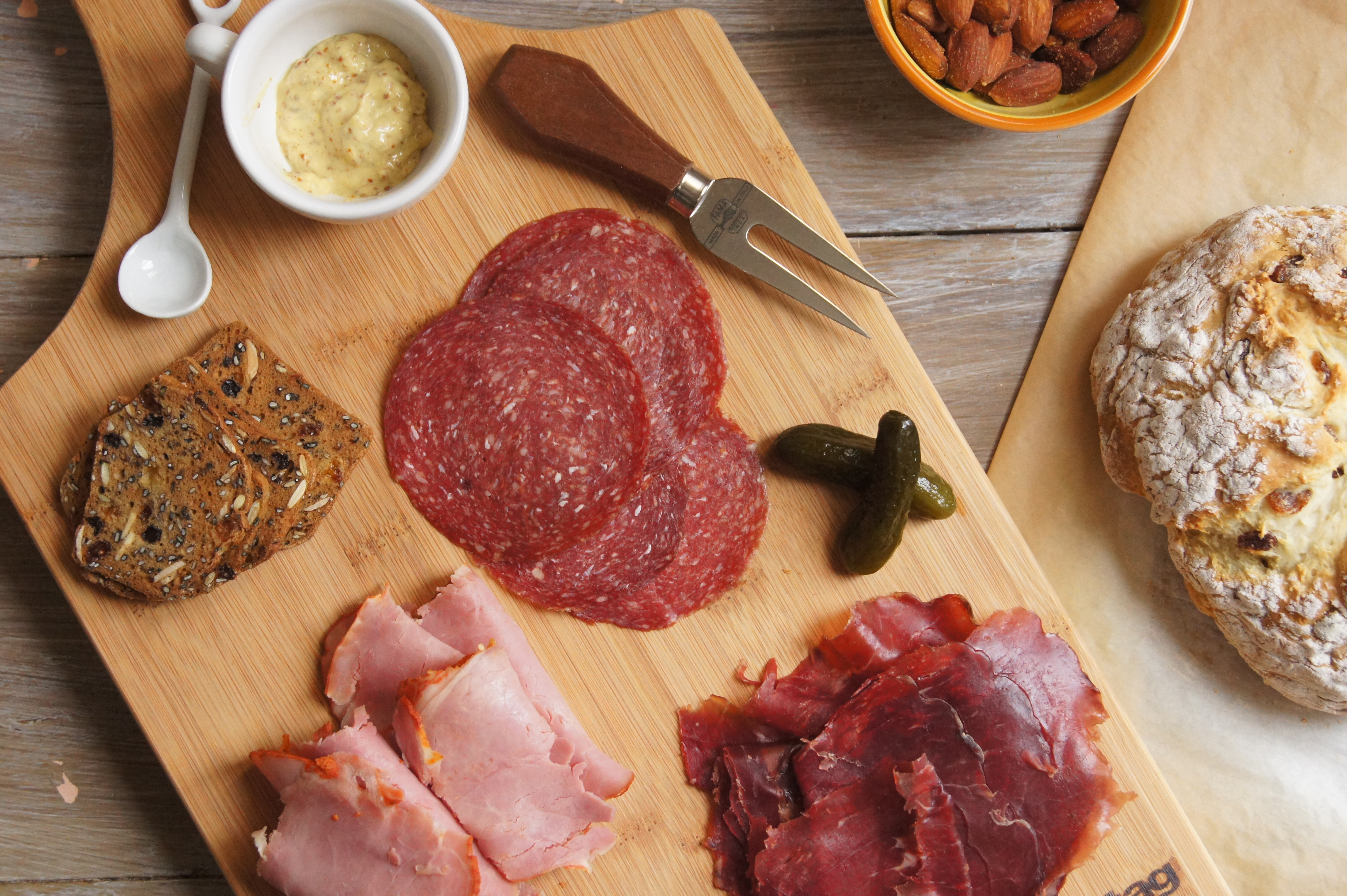 a charcuterie platter with the easiest bread ever profiteroles